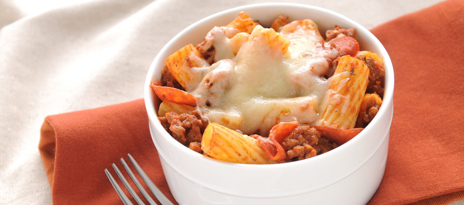Pizza pasta with rigatoni, Italian sausage, pepperoni, sauce and cheese