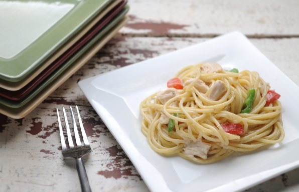 Peppers, chicken, and spaghetti coated in a creamy sauce